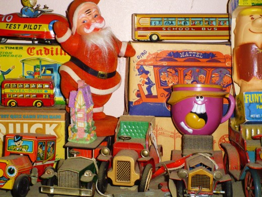 Funny face cups   for drink mixes sold way back when, Goofy Grape, Ollie Orange and old Lefty Lemon, a Santa Claus waving, made of very soft felt, that they sprayed over plastic like a chinchilla pelt. Some early jalopies and a school bus of tin