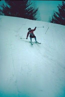 A cross country skier navigating one of the smaller hills in the Canadian Ski Marathon.