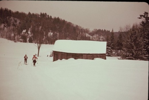 Skiing Past a farm building along the trail of the Canadian Ski Marathon.