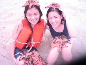 Sarah and justine enjoying the white beaches of Palawan