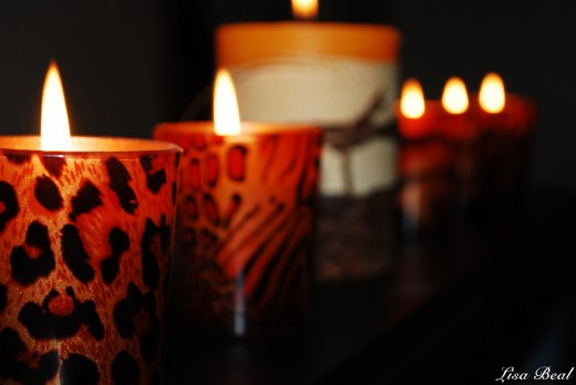 Just a random photo of candles lined up along my TV set.