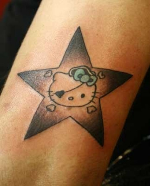 OMG tis an arm hello kitty tattoo in the star design but also as a pirate,