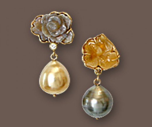 Exquisite carved opal earrings from evejewelry.com