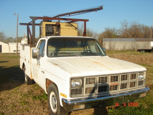 "My trusty truck, ""Ole Paint""! It's a GMC with a 327 sportin' chrome valve covers and doubled up glasspack mufflers. It may look like a weldin' truck but it's a barn-burner. That's a full-blown welder up top and toolboxes on both sides. I used it in m"
