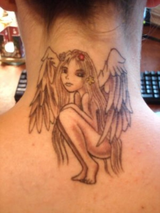 Wowwww doncha love this angel tattoo, hands up if it's yer fav tattoo so far