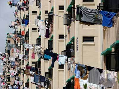 In Singapore, people hang their laundry on bamboo poles. Now, that takes some serious muscles to swing the poles full of clothes out the window--a workout on its own. And when it rains several times a day, your workout increases!