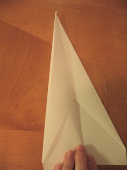 Fold down the wing, using the straight edge to line up the wing.