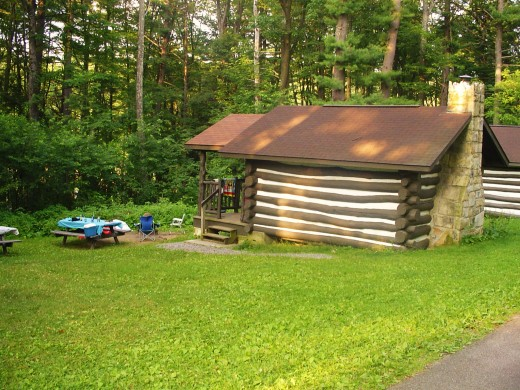 A picturesque log cabin nestled on the ridge of a mountain that sleeps four comfortably.