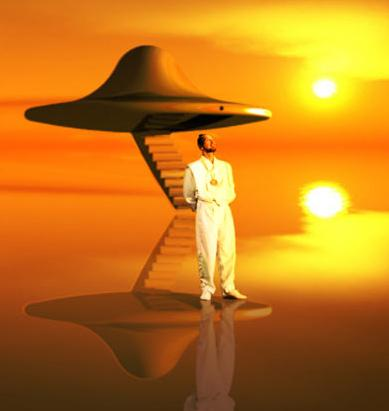 Present Rael posing in front of a model flying saucer