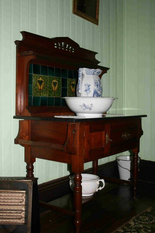 "Wash stand in the ""best bedroom"" - note the ""guzunder""!"