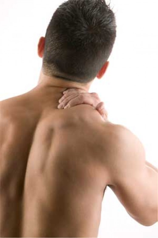 Man Rubbing Upper Back, Showing Back Pain