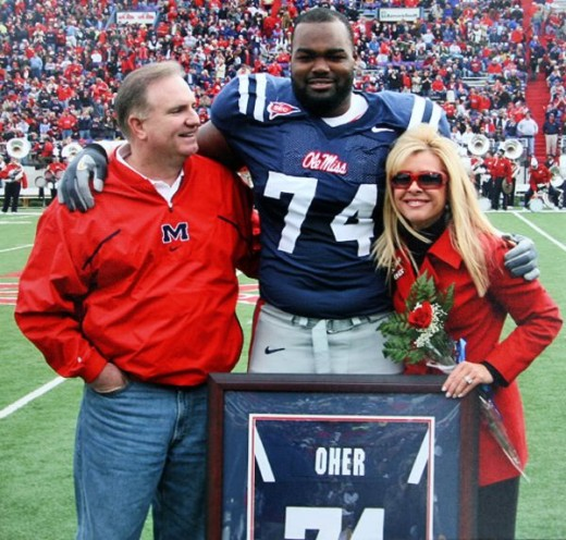 Here pictured are the real life people on which The Blind Side is based on. Pictured is Coach Cotton, Leigh Ann Touhy and Michael Oher.