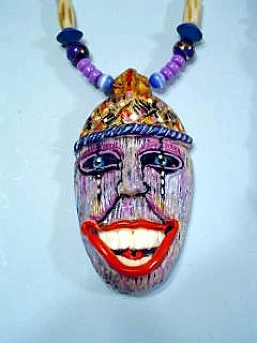 One of my Tiki necklaces, wear a smile no matter what your mood is.