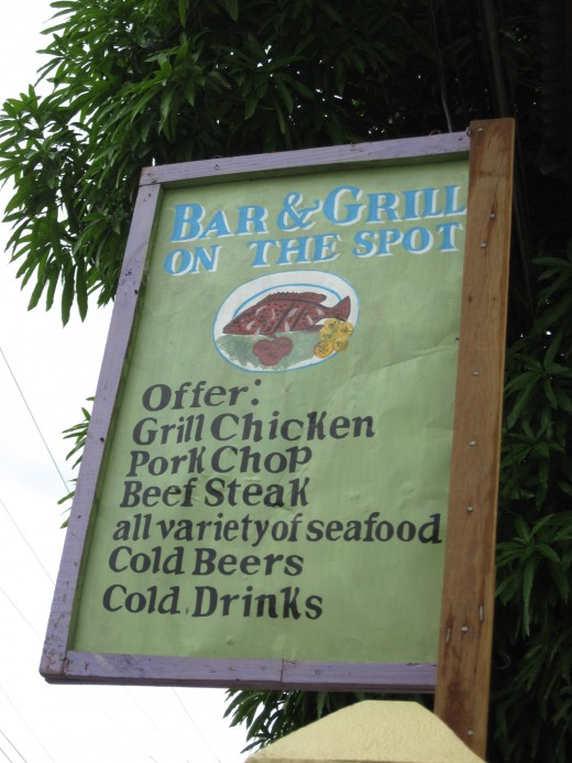 Sign Outside the Bar and Grill on the Spot in Coxen Hole, Island of Roatan, Honduras