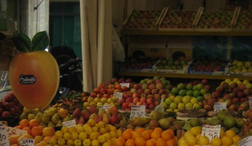 photo: a fruit and vegetable market stall.