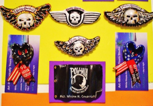 Some Harley~Davidson older logo pins and a POW-MIA flag pin