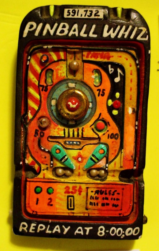 "this is one of several hundred pinball machine pins made for the Rock opera ""Tommy!"" By the Who."