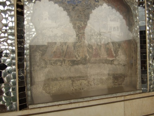 An ancient painting protected by glass
