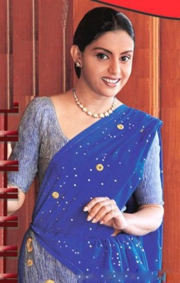 Yashoda Wimaladharma in a blue saree