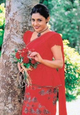 Yashoda in a red saree