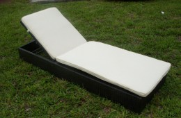 Outdoor wicker chaise lounges are adjustable for sitting up, reading and sleeping while enjoying the backyard resort.