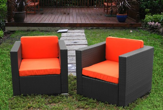 Two deck chairs to match larger resin wicker sets in the backyard.