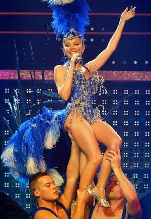 A breast cancer diagnosis forced Kylie Minogue to cancel her 20-show national greatest hits tour: Kylie Showgirl. 13 months later, however, she was back.