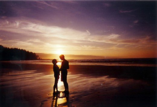 A lovely sunset whilst on a beach can be romantic backdrop.