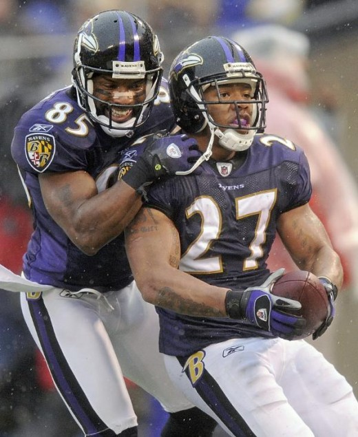 Baltimore Ravens wide receiver Derrick Mason, left, celebrates running back Ray Rice's, right, second-quarter touchdown during an NFL football game against the Detroit Lions, Sunday, Dec. 13, 2009, in Baltimore. (AP Photo/Nick Wass)