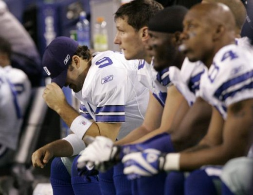 Dallas Cowboys quarterback Tony Romo (9) pulls his cap over his face as the their NFL football game against the San Diego Chargers winds down, Sunday, Dec. 13, 2009 in Arlington, Texas. The Cowboys lost 20-17. (AP Photo/Amy Gutierrez)