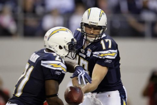 San Diego Chargers running back LaDainian Tomlinson (21) take the handoff from quarterback Philip Rivers (17) during an NFL football game against the Dallas Cowboys, Sunday, Dec. 13, 2009, in Arlington, Texas. (AP Photo/Tony Gutierrez)