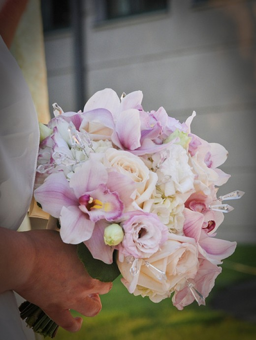 Rose and orchid bridal bouquet with crystals.