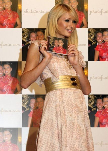 Template from Photofunia wit hParis Hilton-In the photos is Vinny and Michelle Hui.