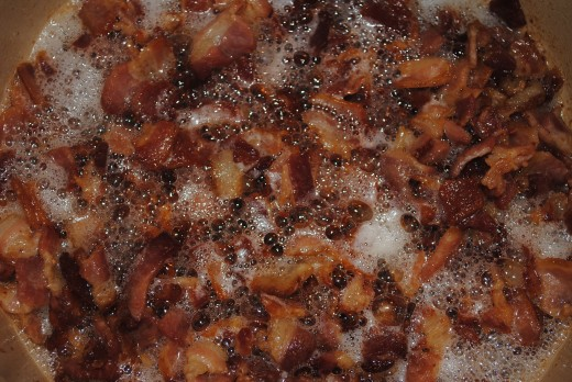 Crispy bacon is just beautiful. This is the start. Rendering over medium low helps get the most fat out of the bacon and achieve the crispiest result.