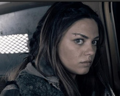 Mila Kunis as Solara, about to blow up an armored truck with a grenade - just one of the super violent scenes in Book of Eli.