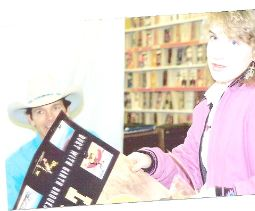 The first time I met Chris LeDoux. (I now have that signed poster framed on my wall)        Photo Courtesy of and Copyrighted by Jack Honkala