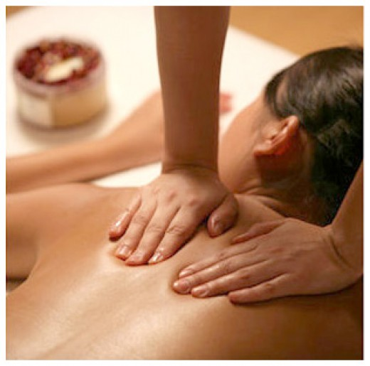 Aromatherapy massage on beautiful back girl with essential oils