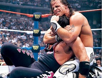 Shawn Michaels applies a chinlock to Bret Hart at WrestleMania 12