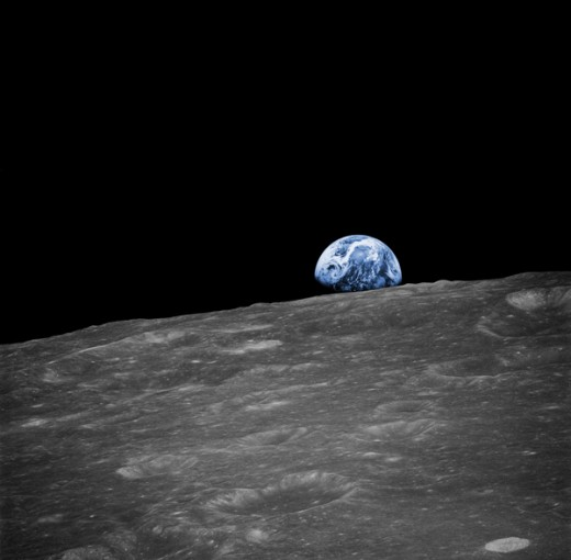 This image is the first ever photograph of planet Earth taken by humans. Named Earthrise, it was shot during the Apollo 8 mission. December, 1968. Color simulated. Photo courtesy of NASA.