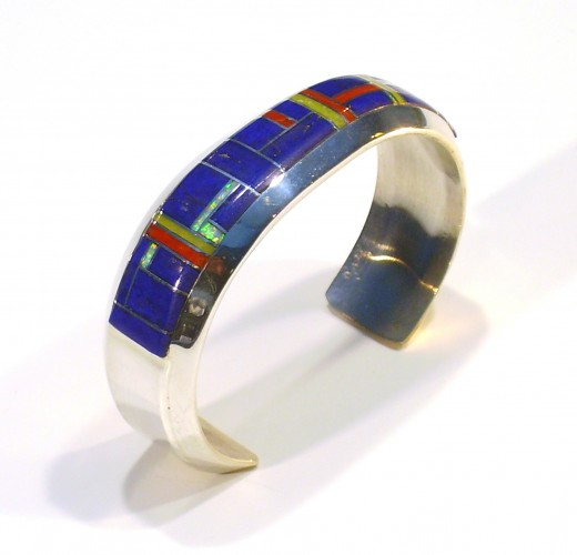 The large size and natural, yet colorful stones make this a bohemian styled silver bangle