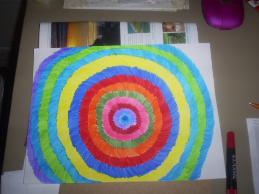 Continue to add color as you reach the edges of the paper.