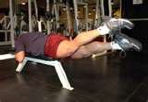You can use a bench or lay on the floor to perform this exercise