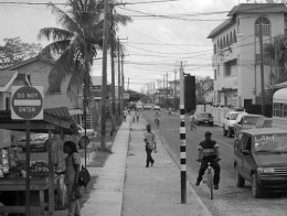 A very nice black and white shot of a street in Belize City.