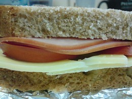 A Packed Sandwich for Lunch - Slices of Whole Wheat Bread, Ham, Tomato, Cheese...