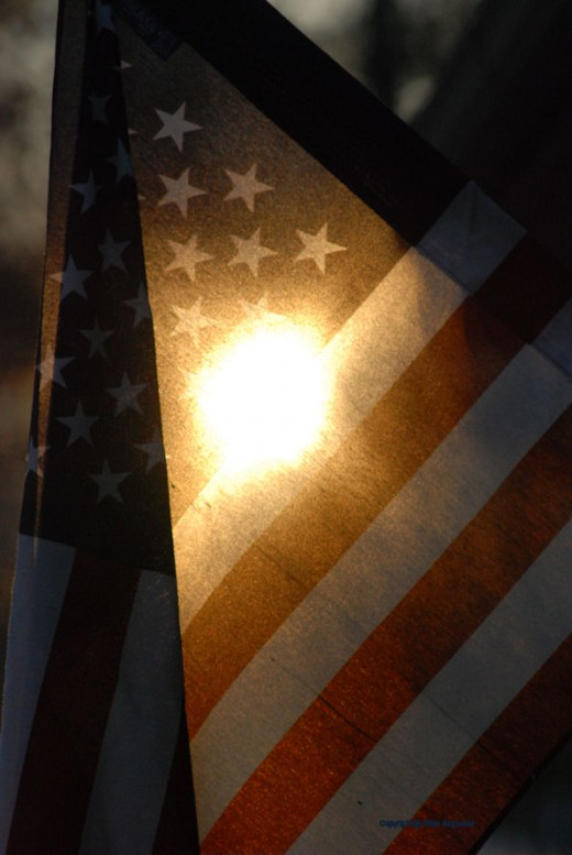 The setting sun filtered through Old Glory.