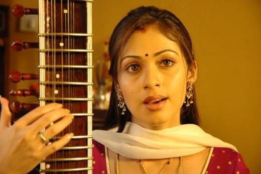 Sadha Play a Music insturment