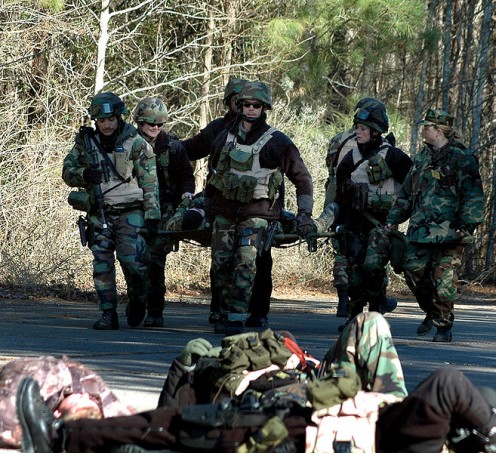 Chesapeake, Va. (Jan. 28, 2005)  Sailors assigned to Mobile Security Squadron Six (MSS-6) carry a wounded comrade during a simulated suicide bomber exercise on board Naval Auxiliary Landing