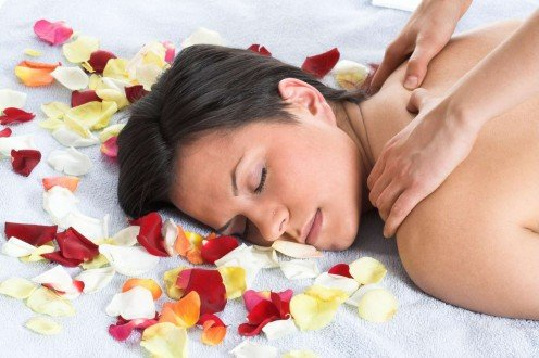 Massaging body with essential oil can lift body, mind and soul.