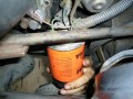 Screw on New Oil Filter (autorepair.about)
