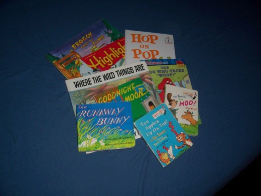 A selection of books from the library. Make the trip to the library like a field trip, and let your child explore.